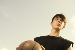 young adult with basketball